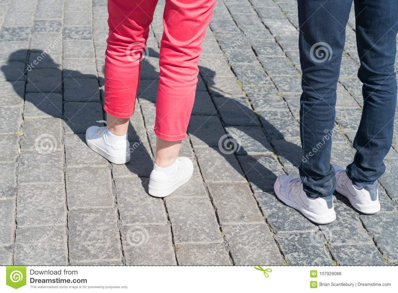 914b9726e Legs Of Two People From Rear Standing Stock Photo - Image of couple ...