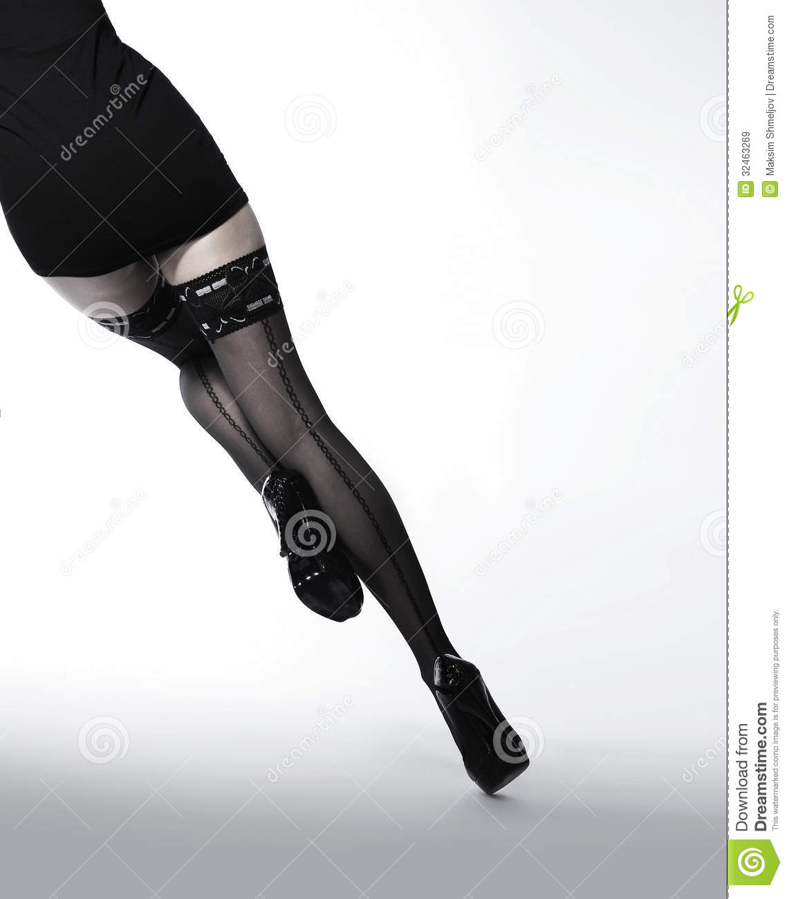 Legs of a young and fit woman in black stockings