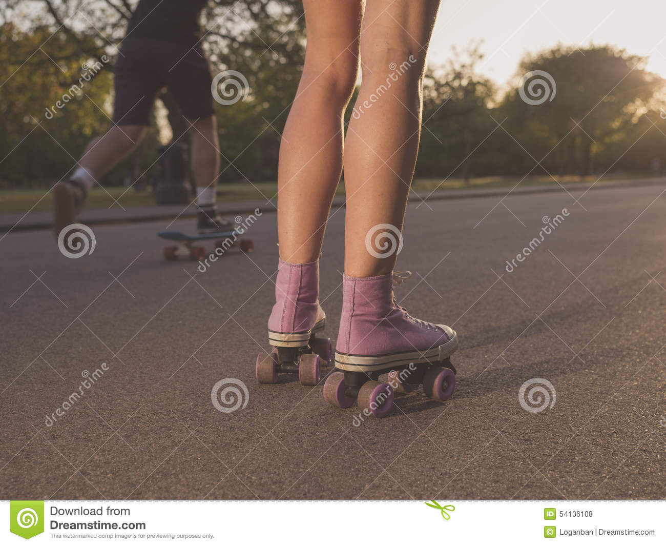Pretty Preteen Girl On Roller Skates In Helmet At A Track