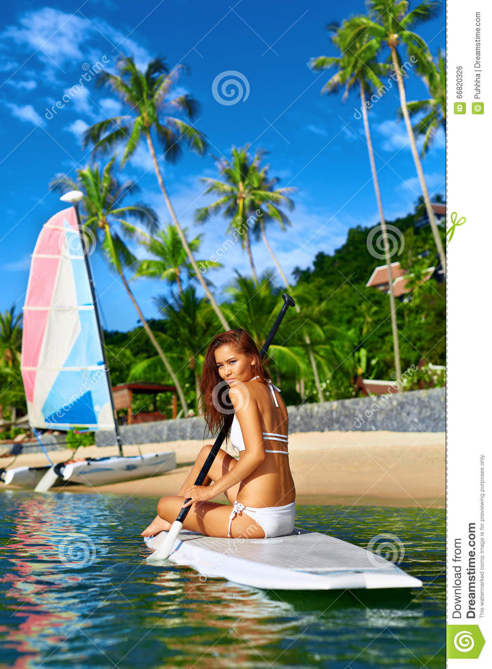 Travel Adventure Woman Paddling On Surfing Board Stock