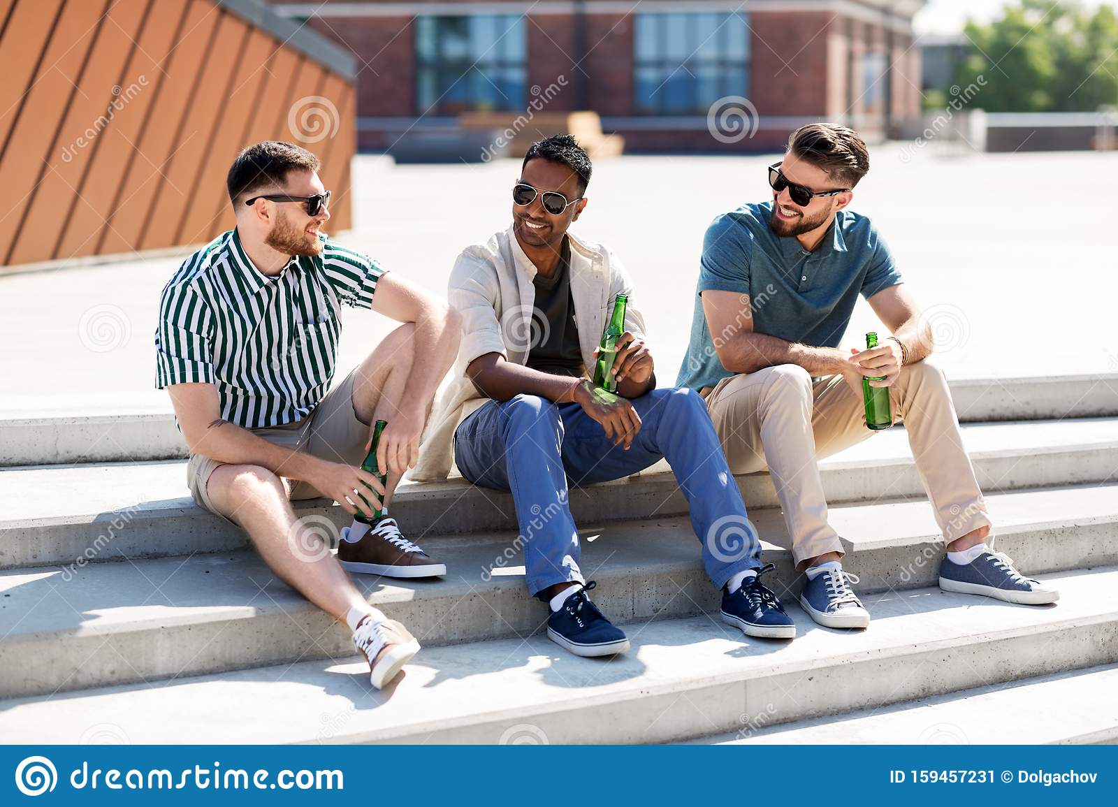 Happy Male Friends Drinking Beer On Street Stock Image ...