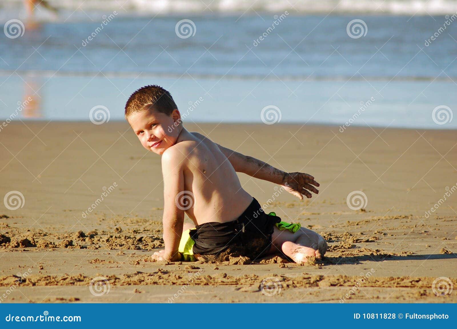 Leka sand för strand