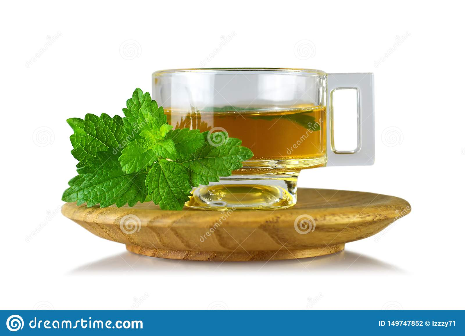 Lemon balm Melissa tea in cup isolated on white background