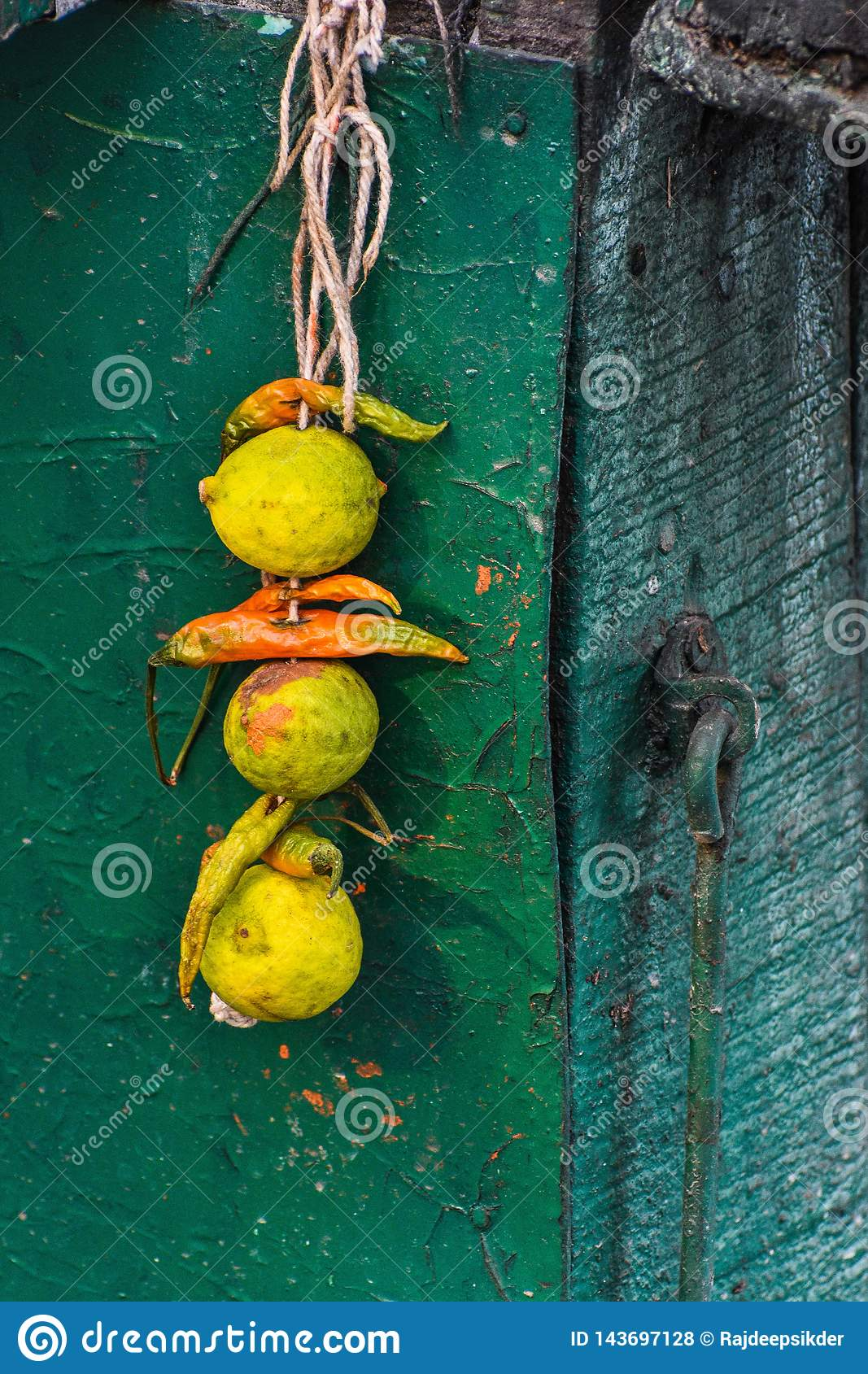 Lemon and chilies tied together with a thread, also known as totka or nazar battu.