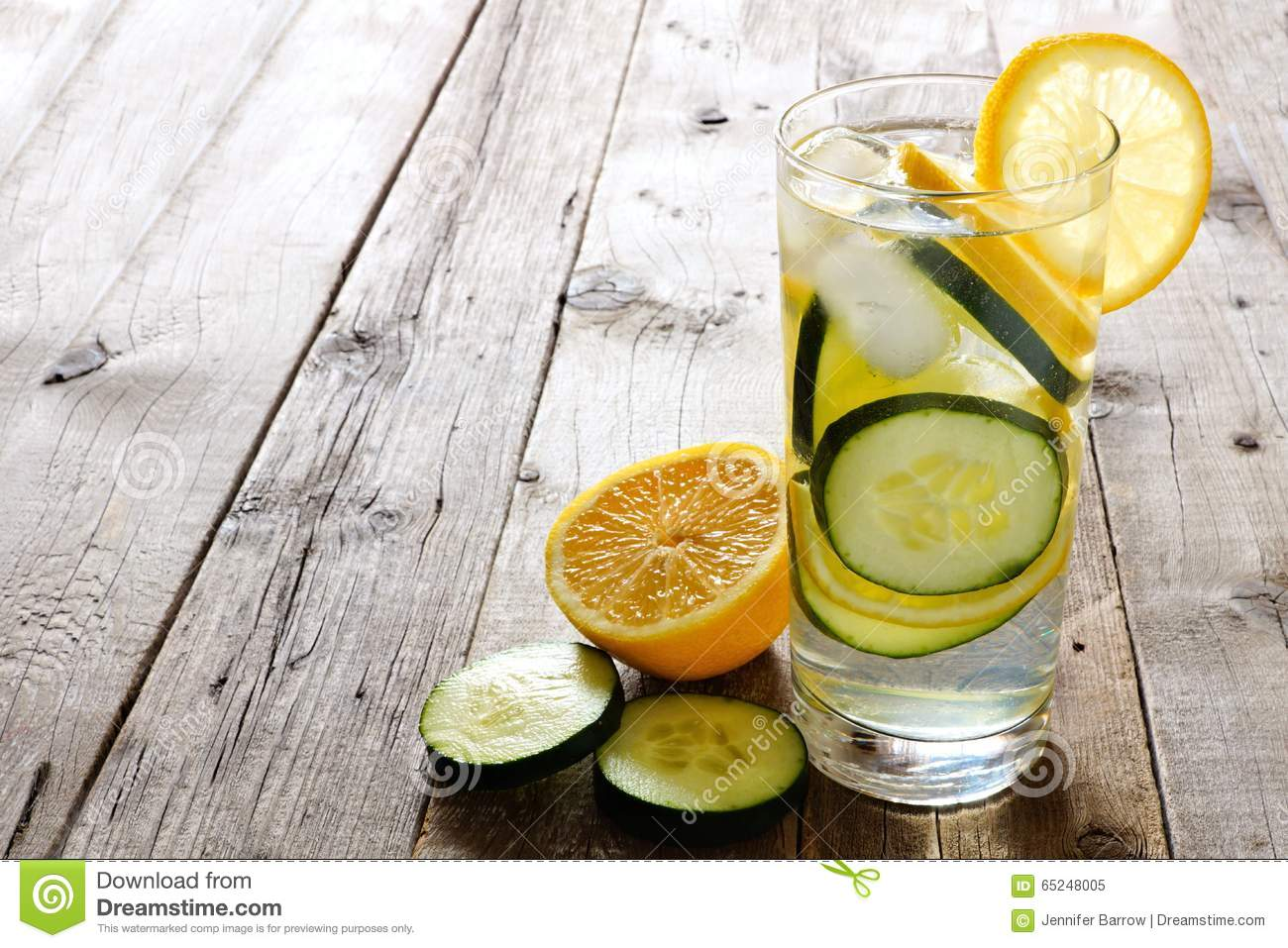 Lemon Cucumber Detox Water In A Glass Over Rustic Wood