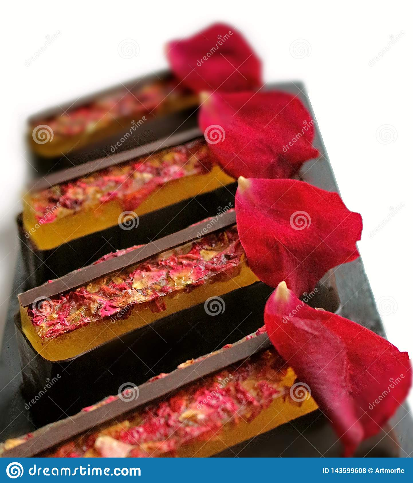 Lemon jelly and chocolate desserts with fresh edible rose petals