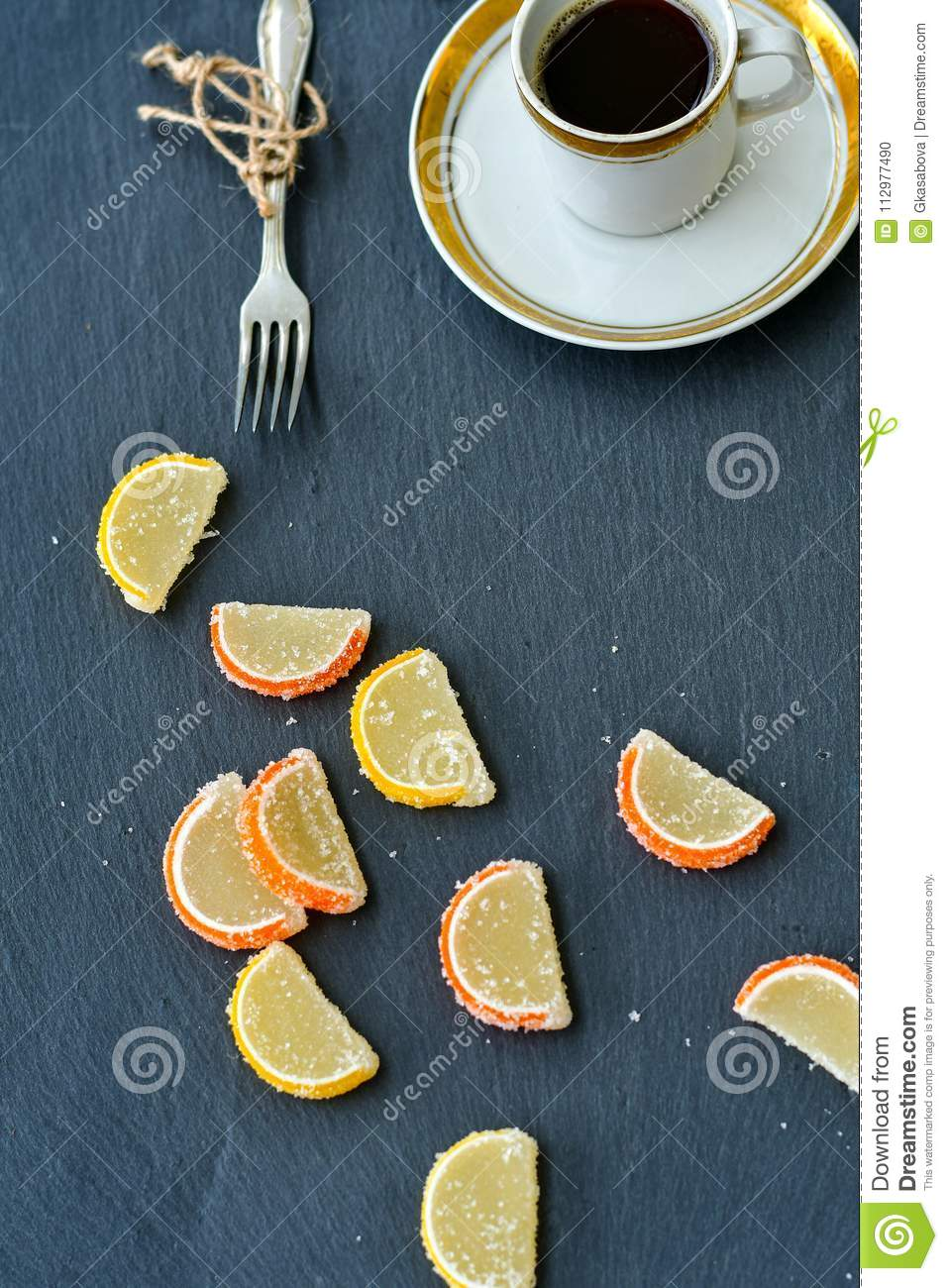 Cup of coffee and lemon slices