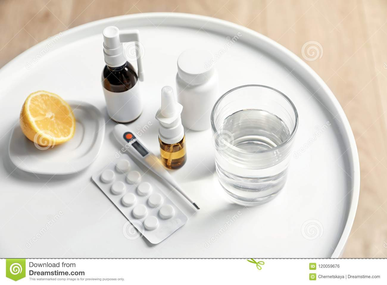 Pills and drugs for cold on table
