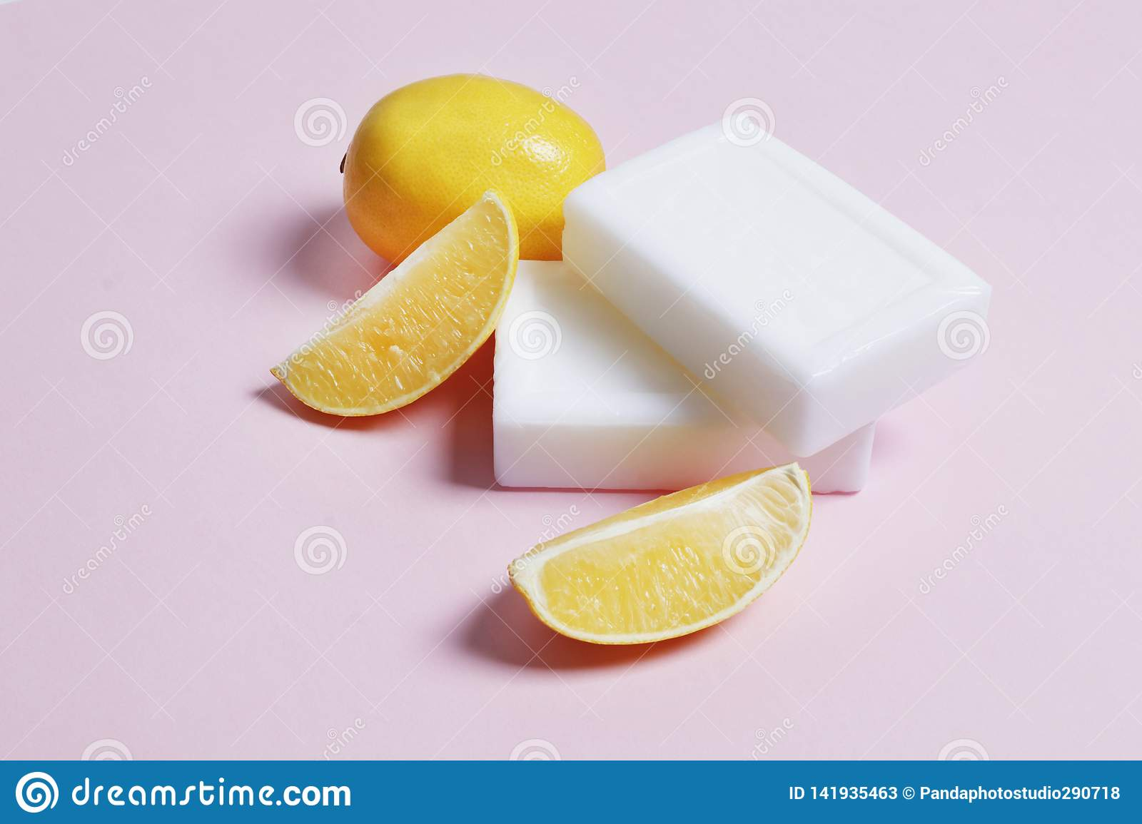 Lemon soap for washing and bleaching things on a pink background