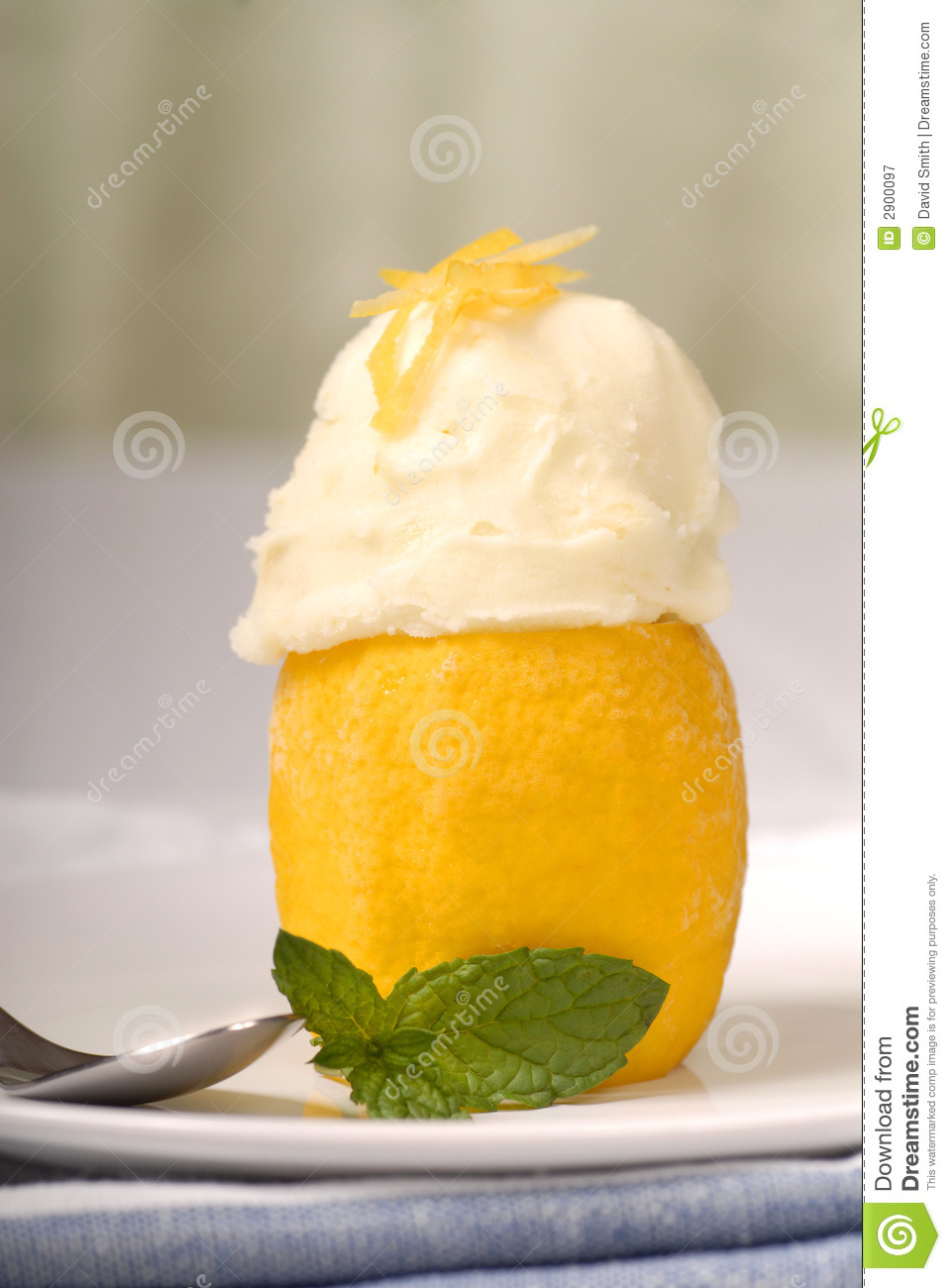 Lemon sorbet in a frozen lemon shell with mint.