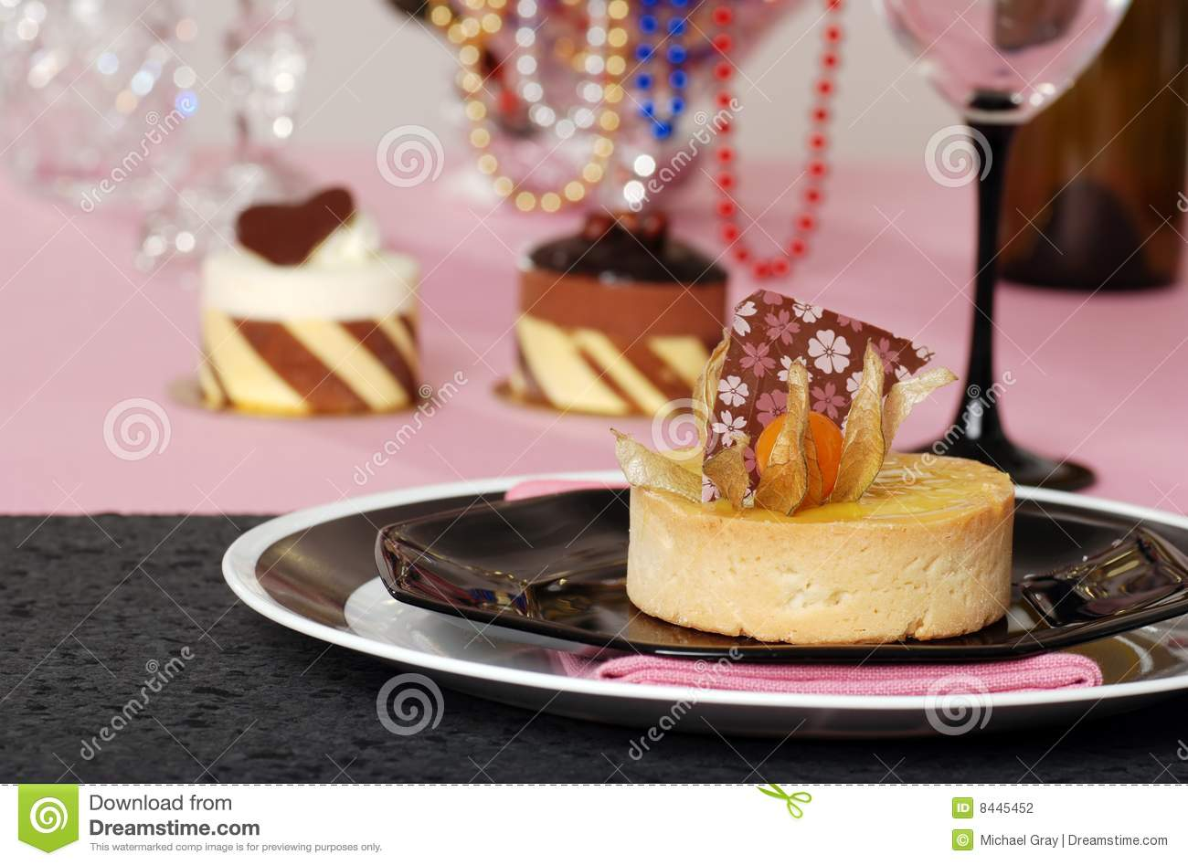 Lemon tart with desserts in the background