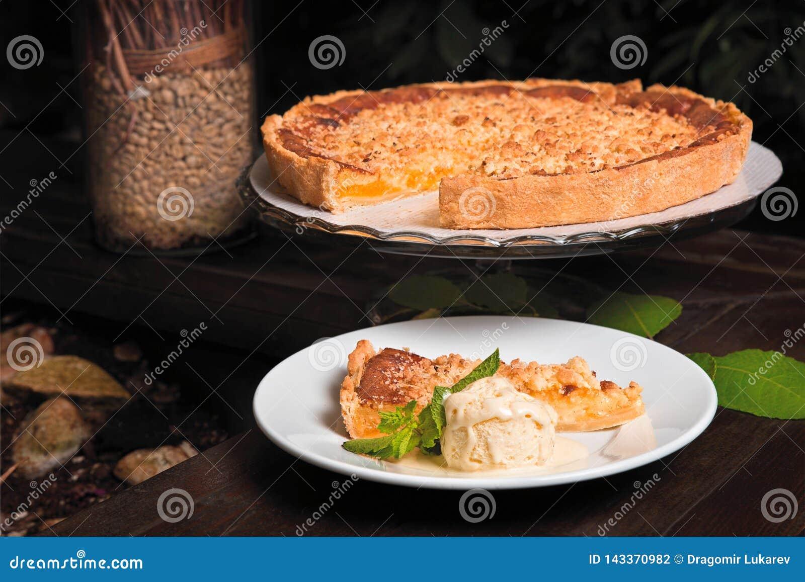 Lemon tart with mint and ice cream.