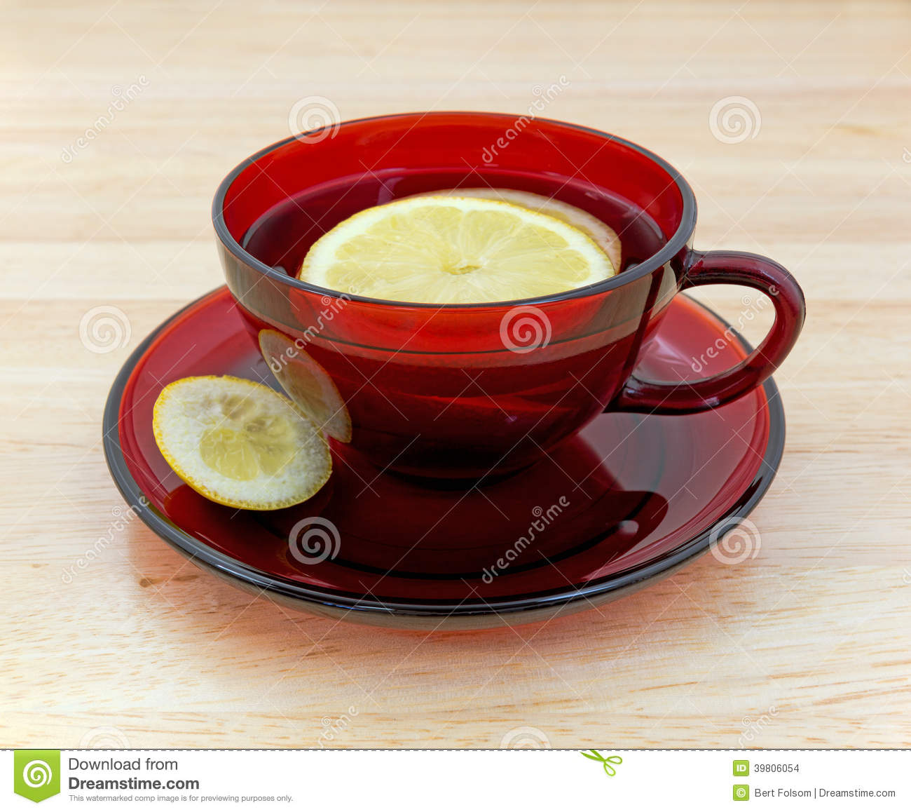 Lemon tea in cup and saucer with rind