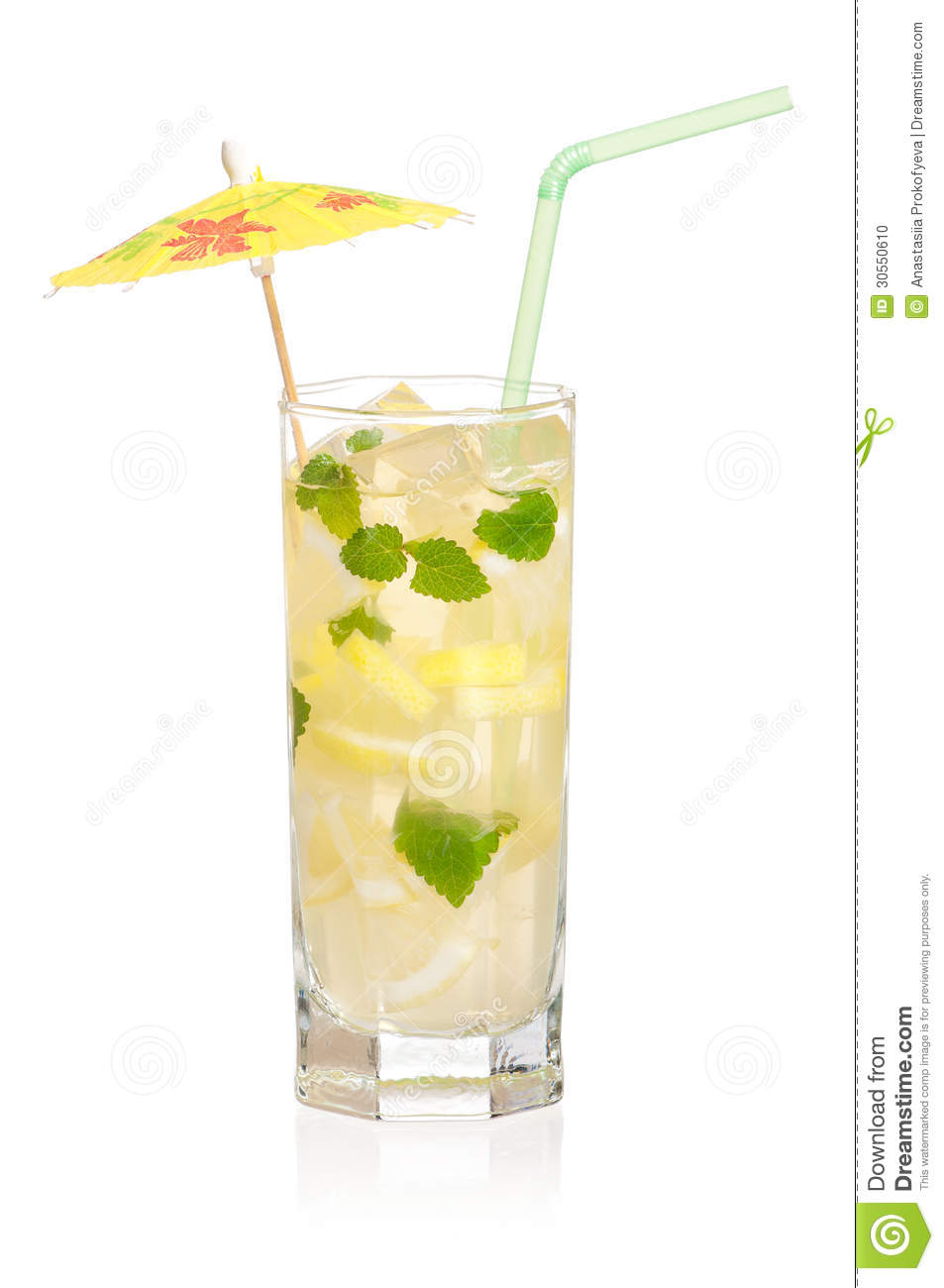 Glass of lemonade with lemon and mint isolated on white background.