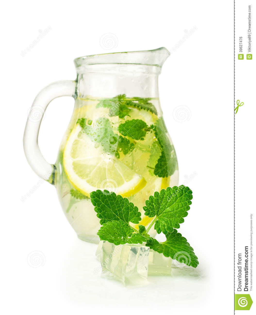 Lemonade with ice and mint in a glass jug stock photo image