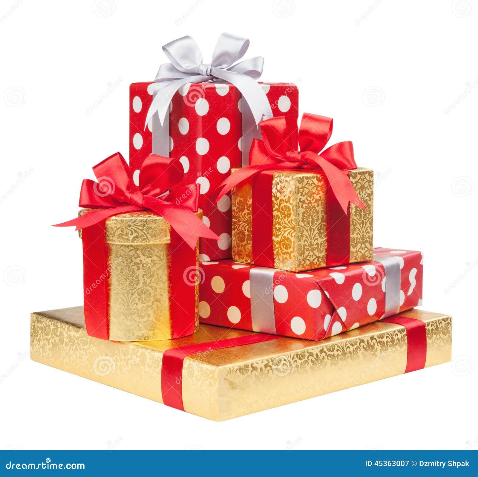 Les boîtes rouges, rayées et d or avec des cadeaux ont attaché des arcs