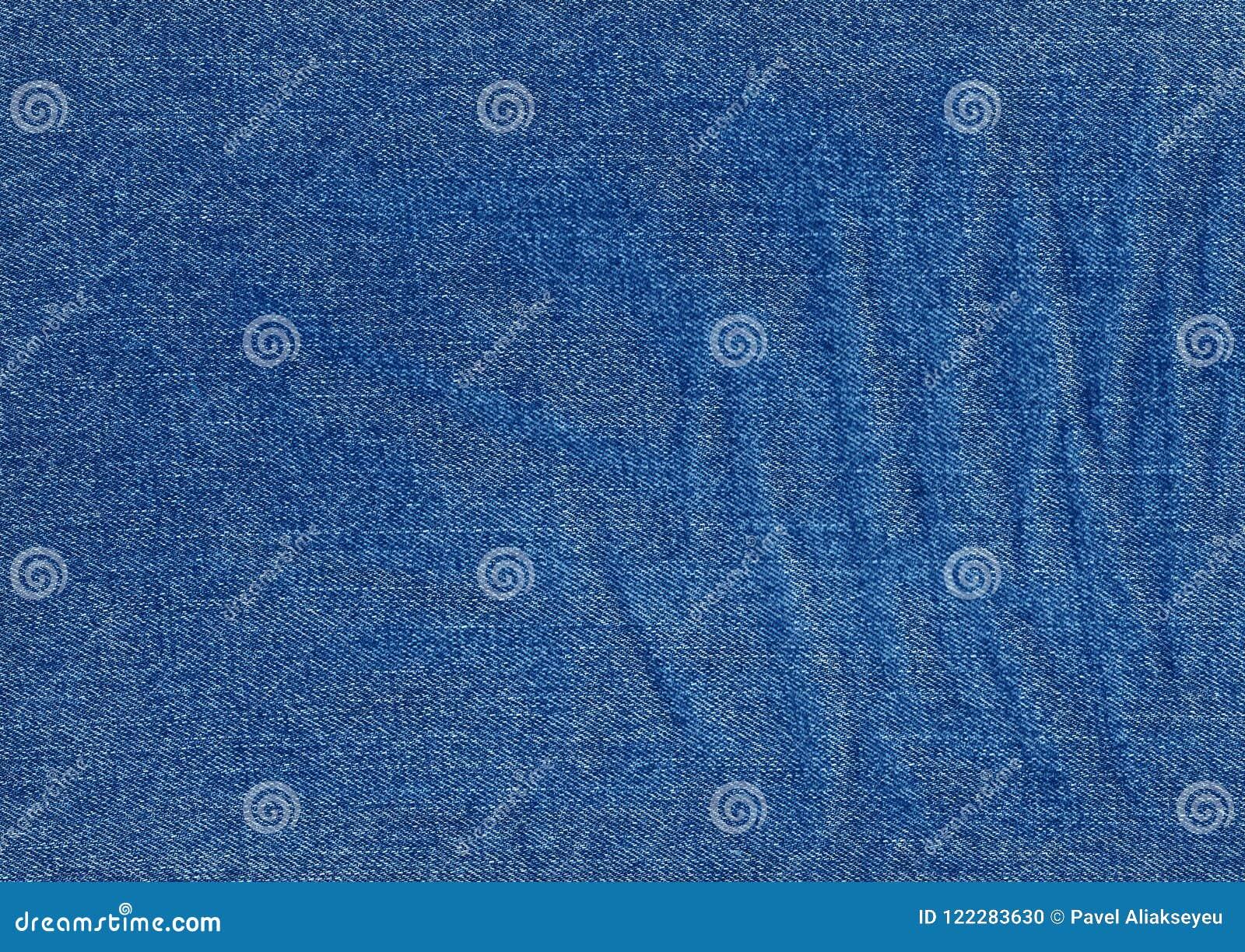 les jeans donnent une consistance rugueuse dans la couleur de bleu