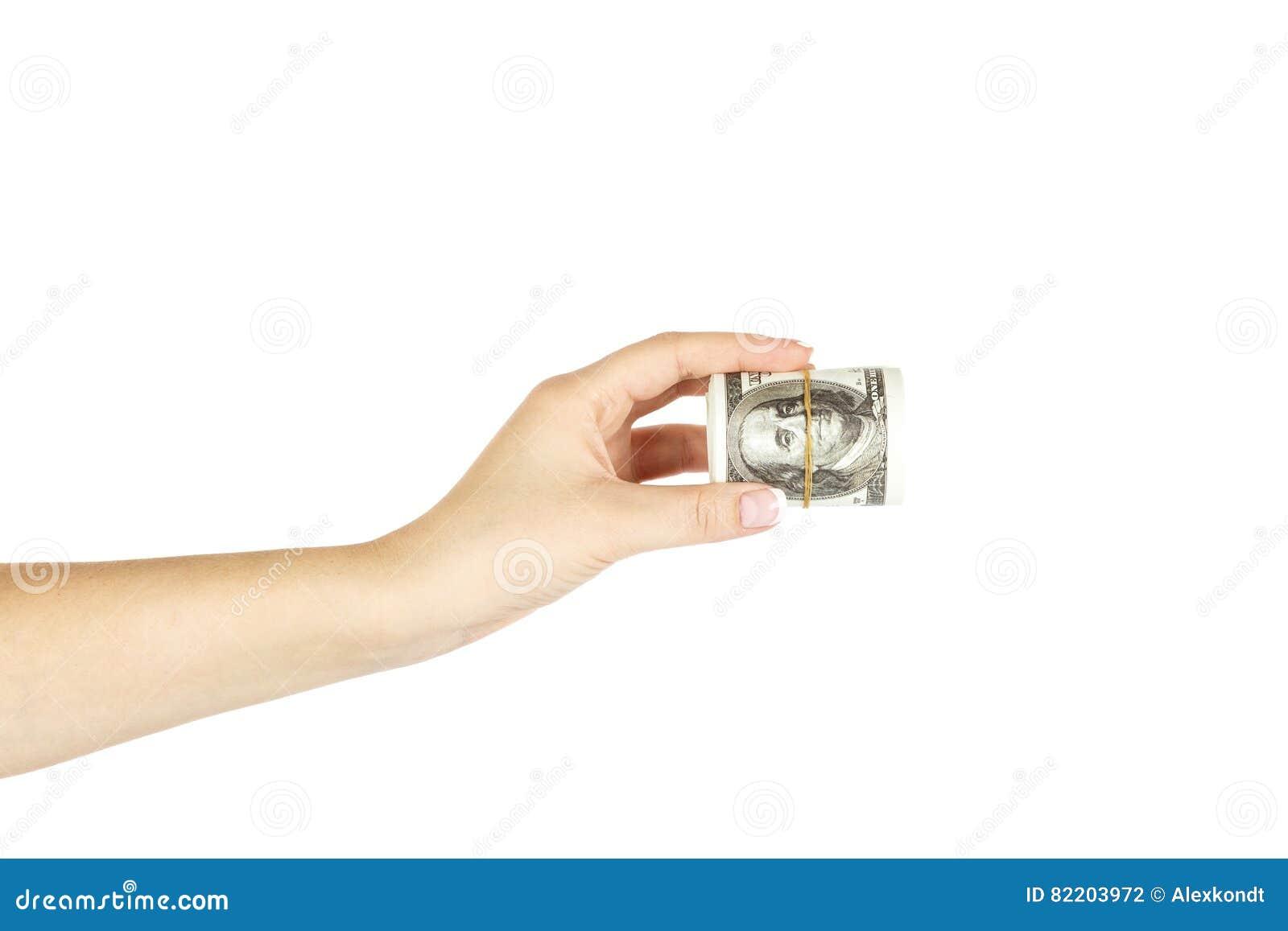 Les prises femelles de main du ` s ont tordu la pile de dollars sur le fond blanc