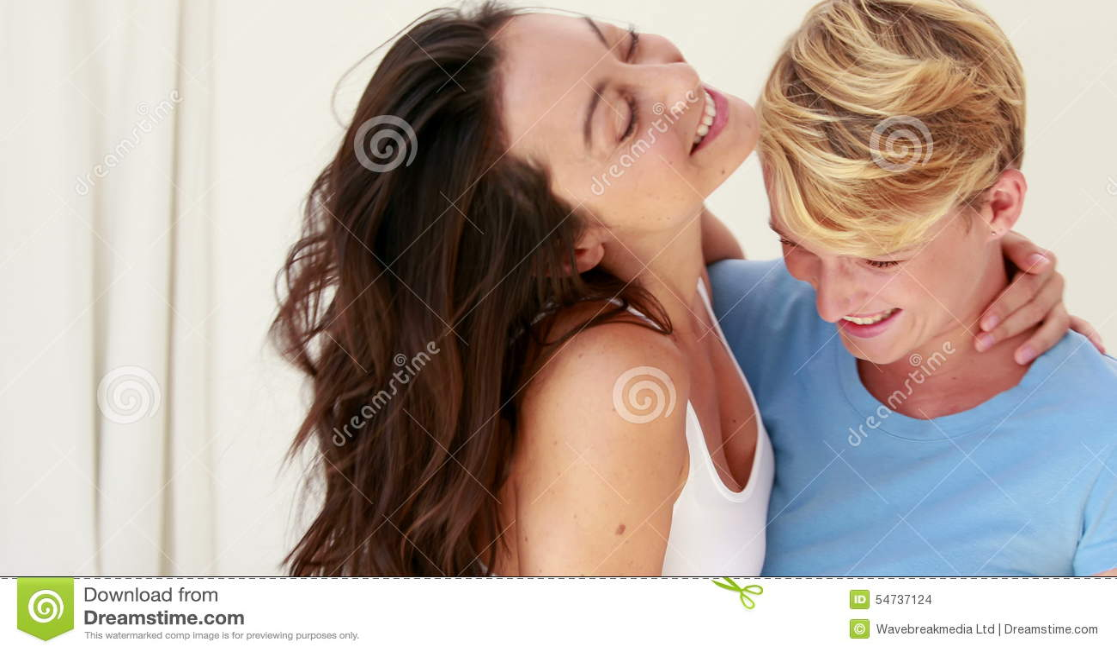 Lesbian having fun on bed