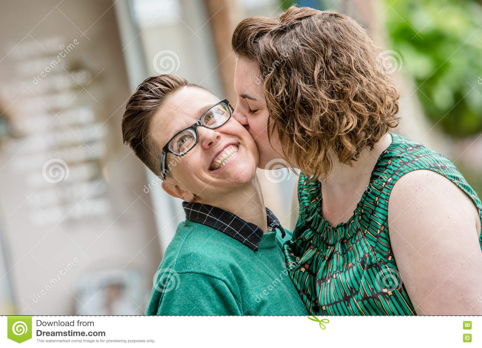 Lesbian couple kissing outdoors