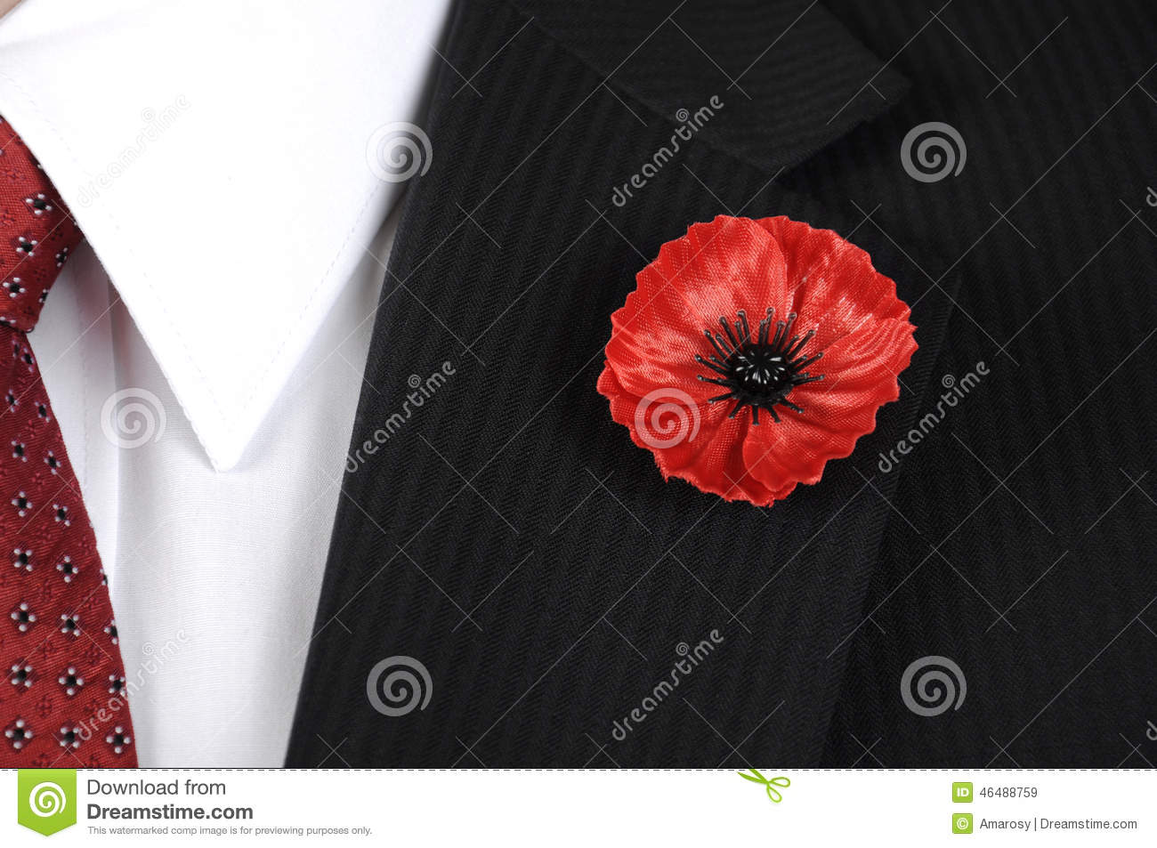 Lest We Forget Red Poppy Lapel Pin Badge On Mans Black Suit Stock