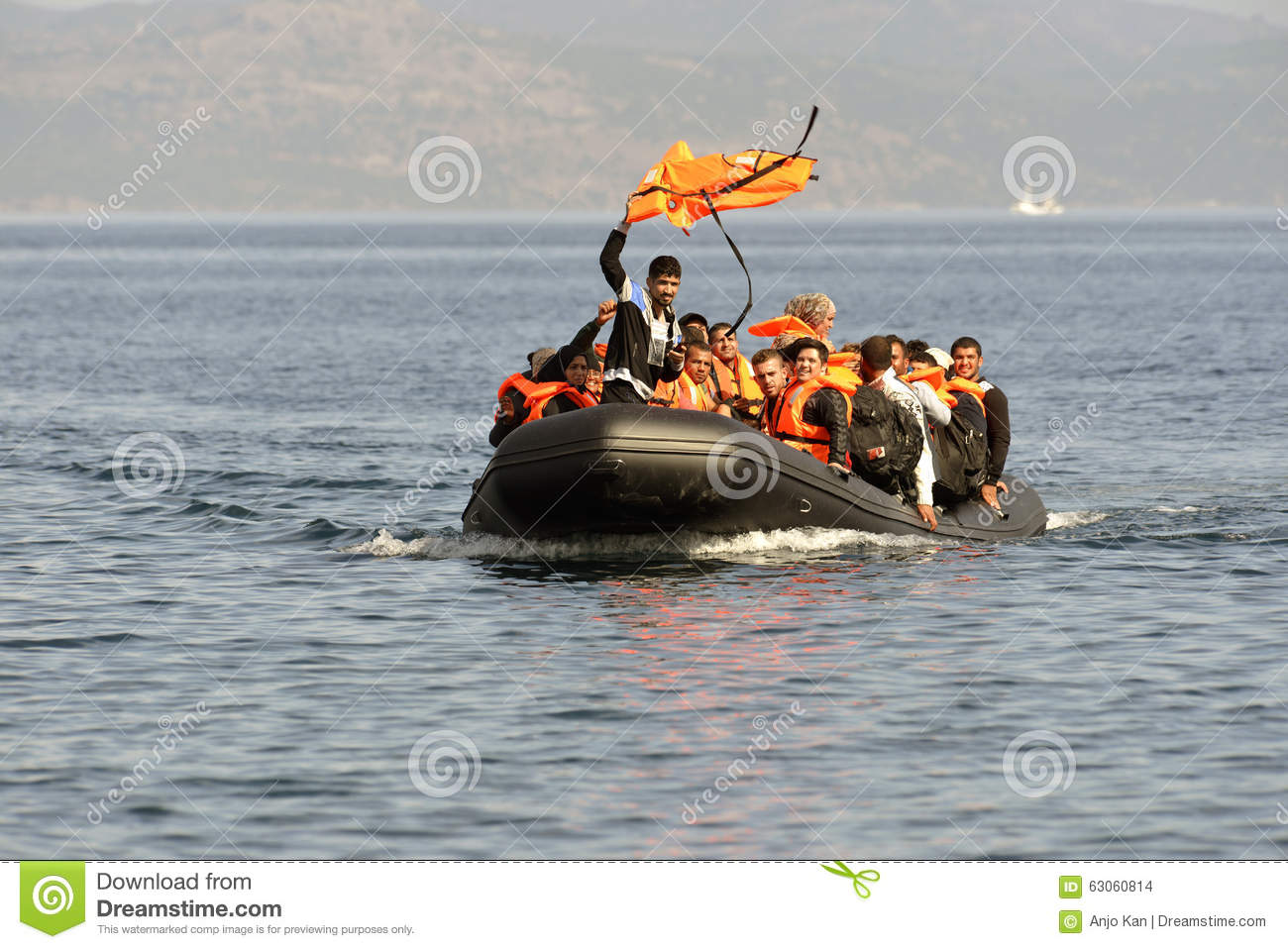 LESVOS, GREECE october 12, 2015: Refugees arriving in Greece in dingy boat from Turkey.