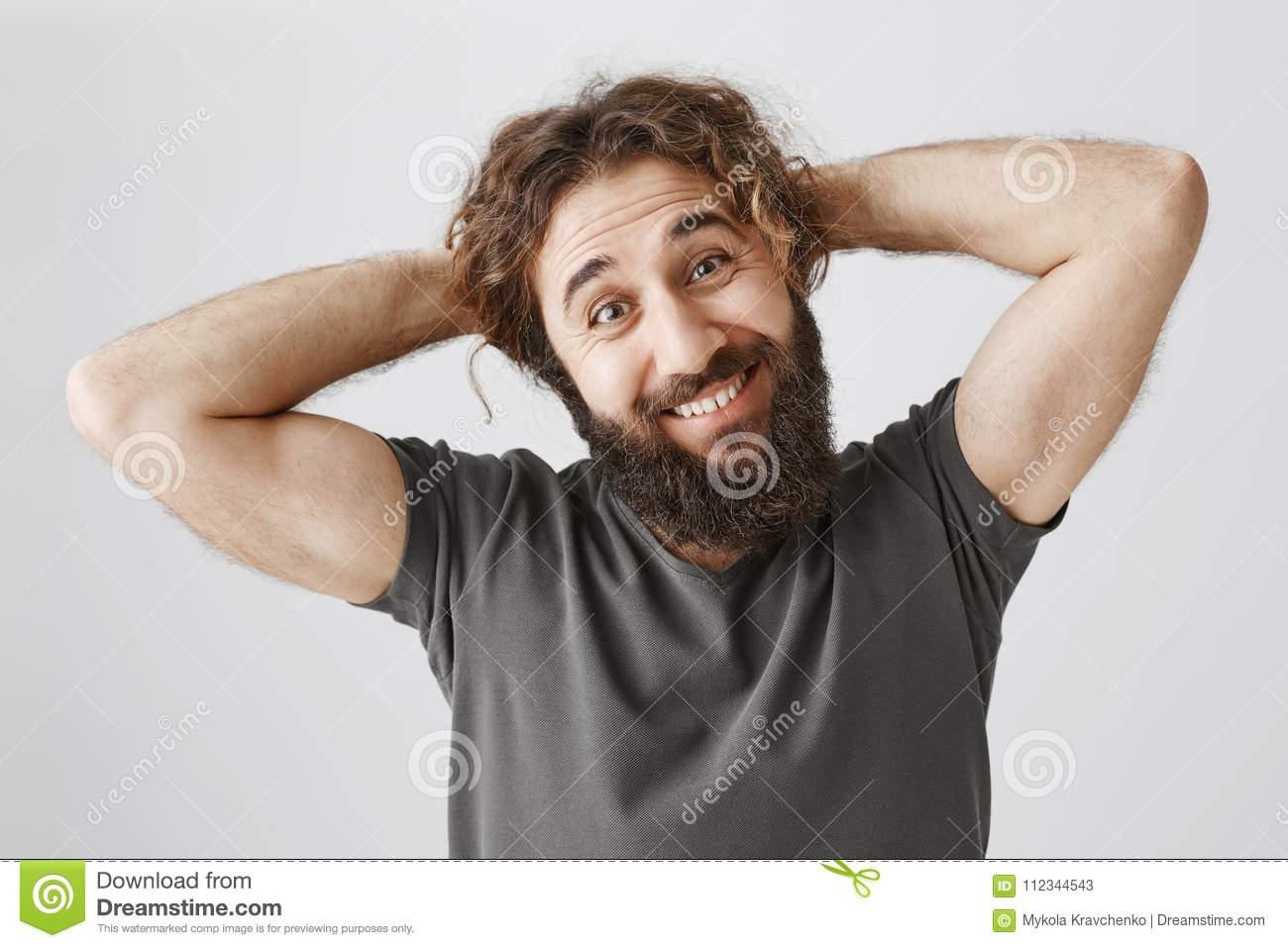Let Me Scrape Hair In Ponytail. Portrait Of Funny Handsome Arabian Guy With  Beard Holding Hands Behind Head And Smiling Stock Image - Image of eastern,  advertising: 112344543