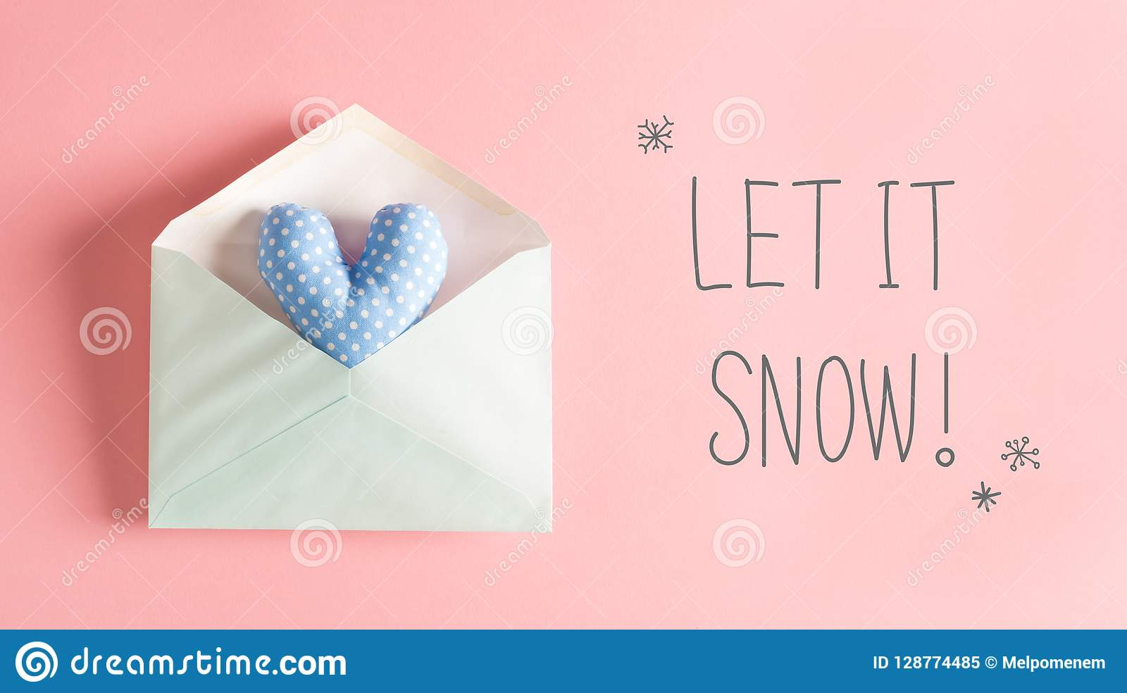 Let It Snow message with a blue heart cushion