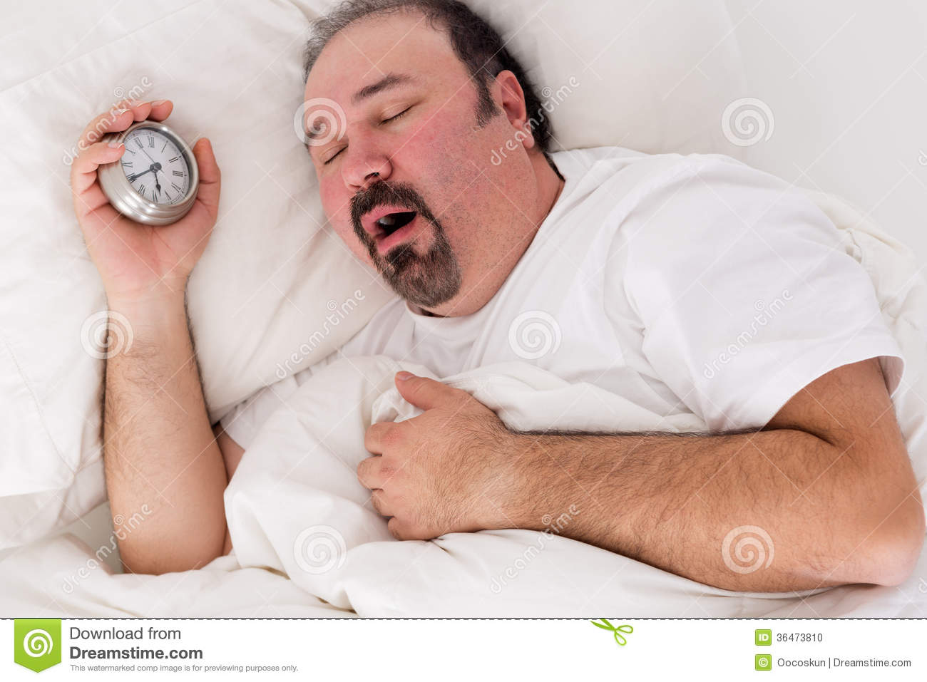 Lethargic man yawning as he struggles to wake up