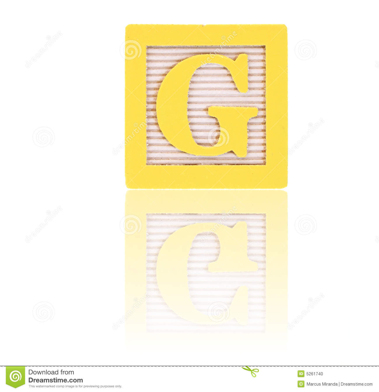 Letter g in an alphabet wood block on a reflective surface.