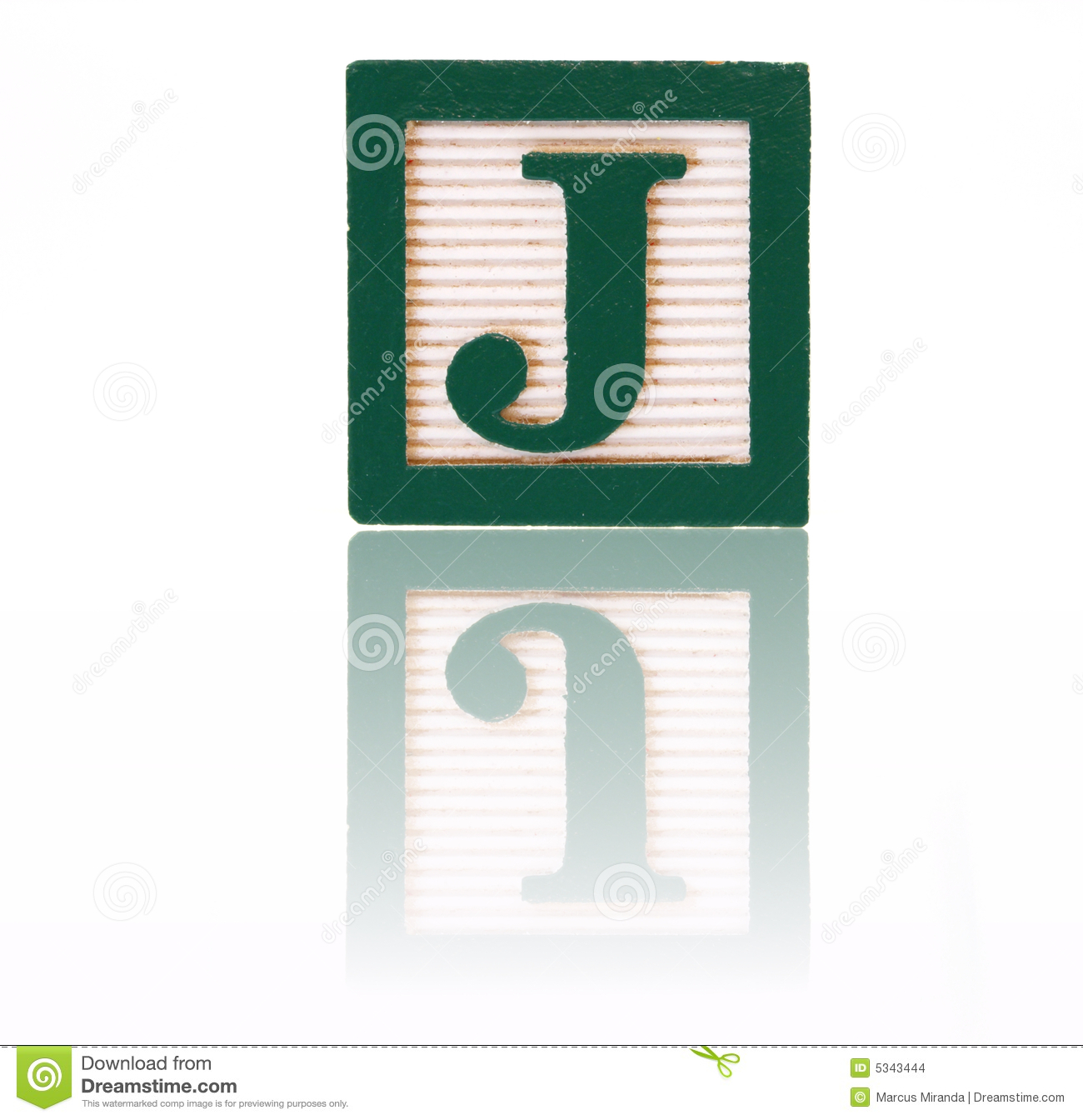 Letter j in an alphabet wood block on a reflective surface.