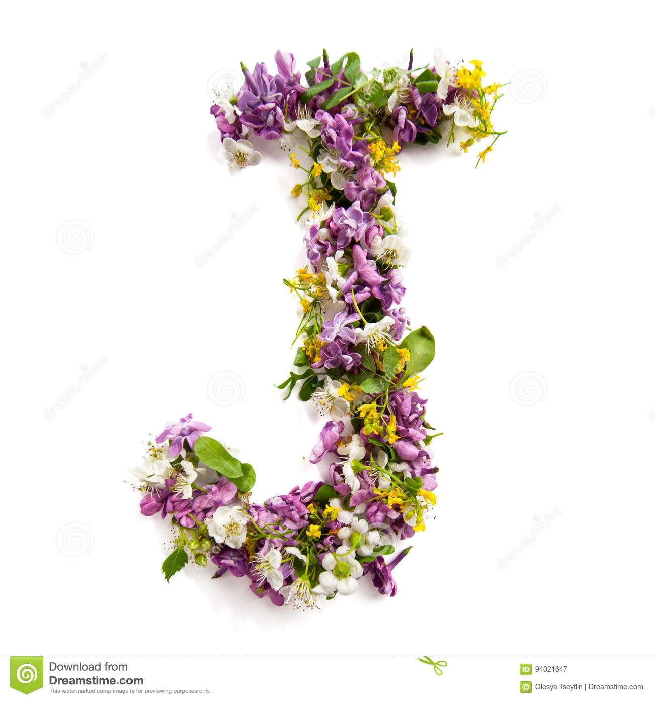 The letter «J» made of various natural small flowers.