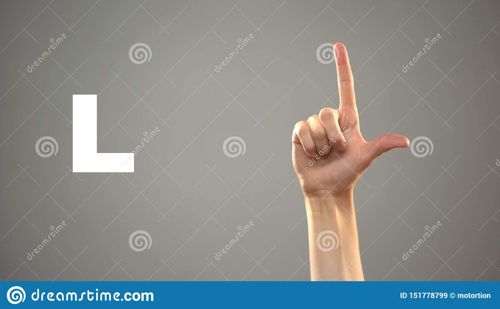 Letter L in sign language, hand on background, communication for deaf, lesson