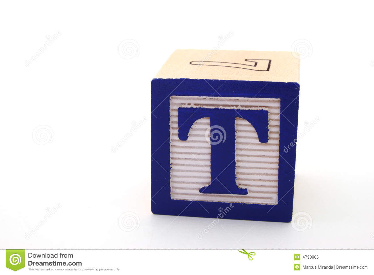 Letter t in an alphabet wood block on a white surface.