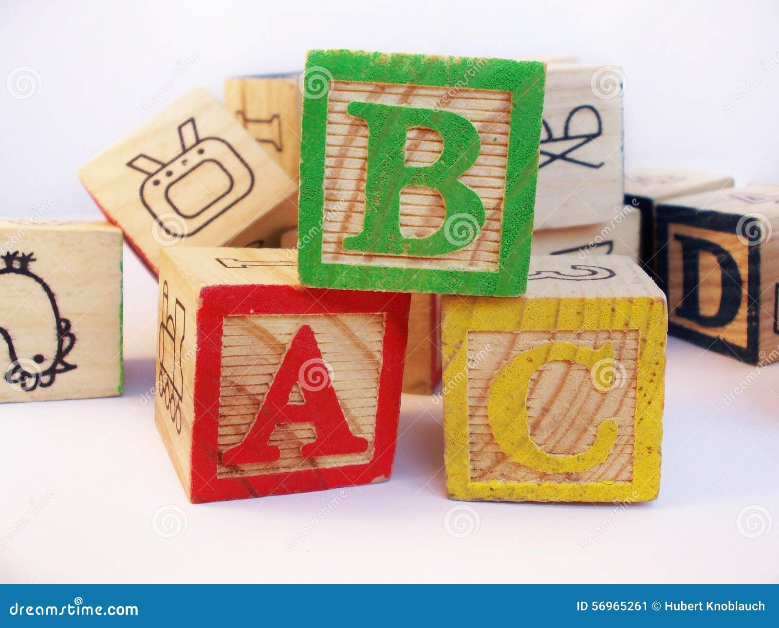 Letters abc on preschool kids wooden block stock photo
