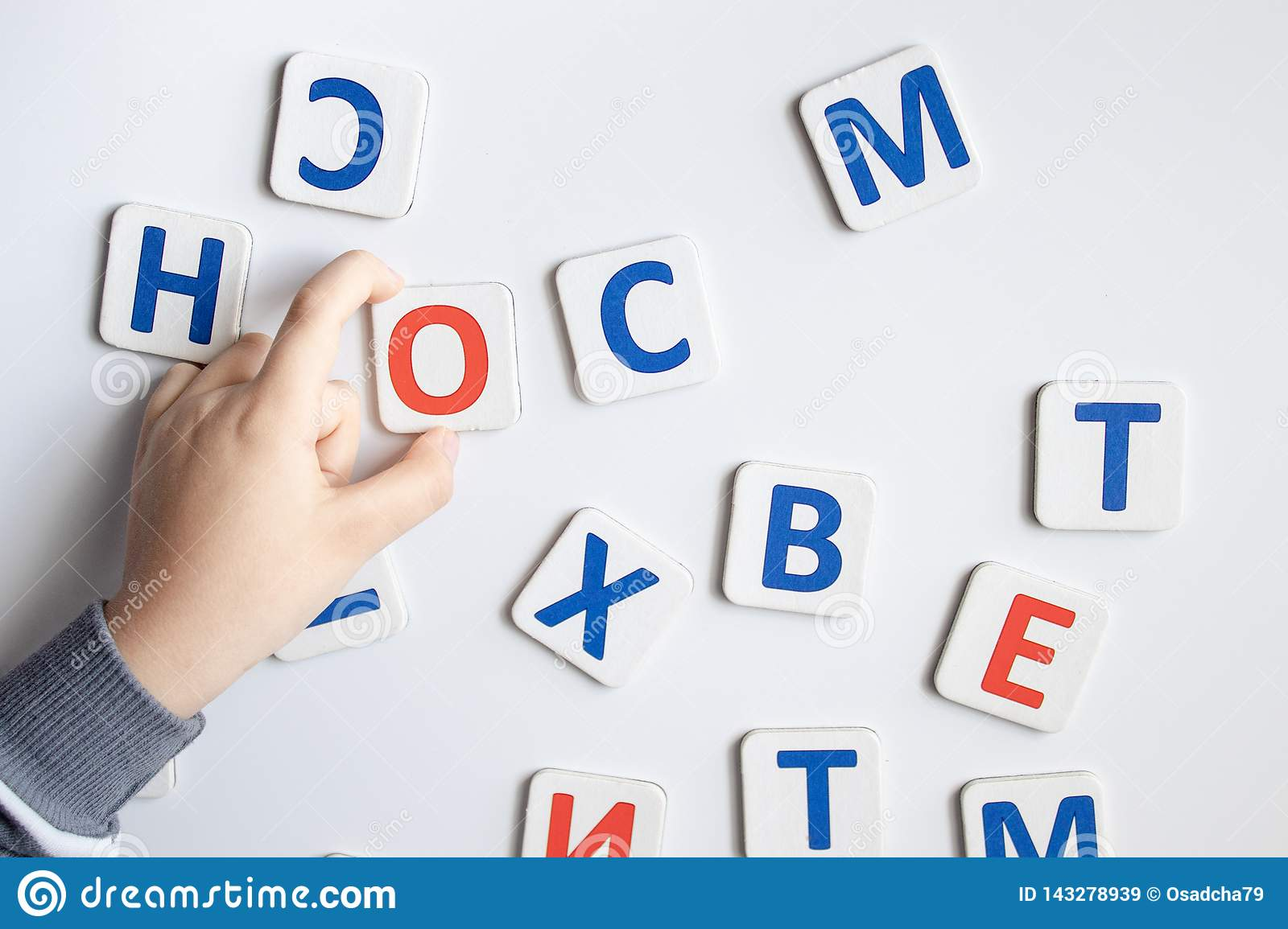 The letters of the alphabet. Against the background of the white school board