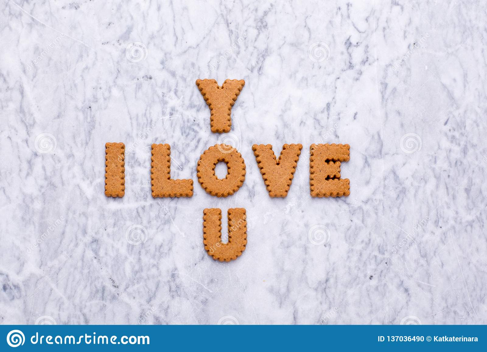 Letters cookies I Love You on marble background
