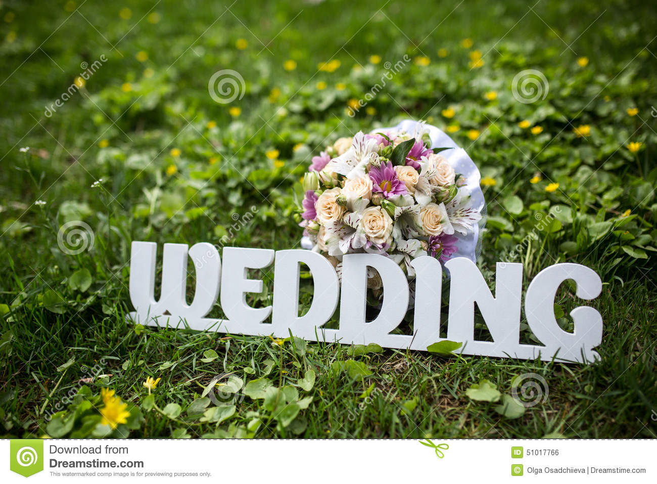 letters wedding on a green grass