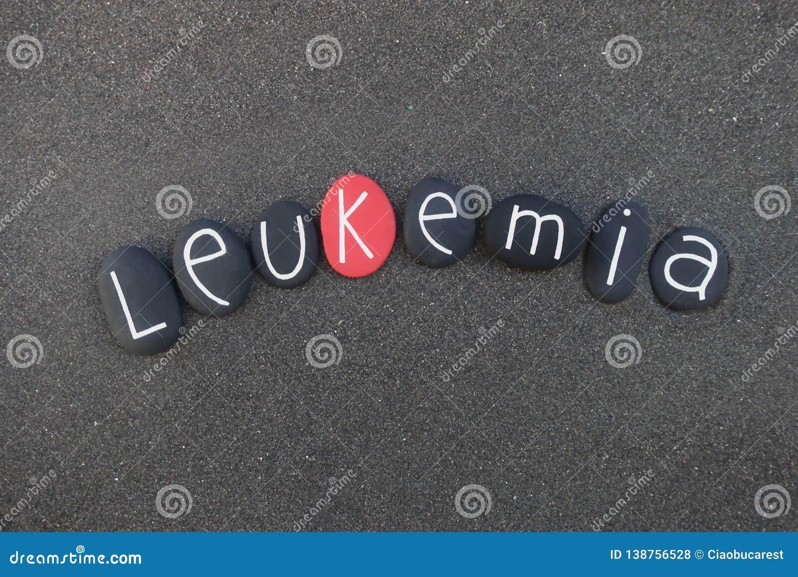 Leucémie, groupe de mot de cancers composé au-dessus du sable volcanique noir avec les pierres pinted noires et rouges