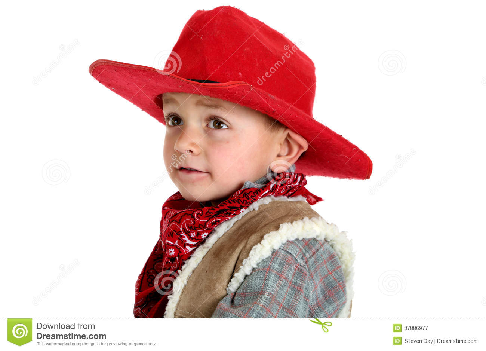 Leuke jonge cowboy in een rode cowboyhoed en een bandana