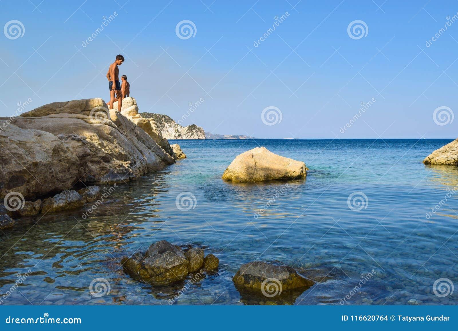 Leute auf dem Felsen