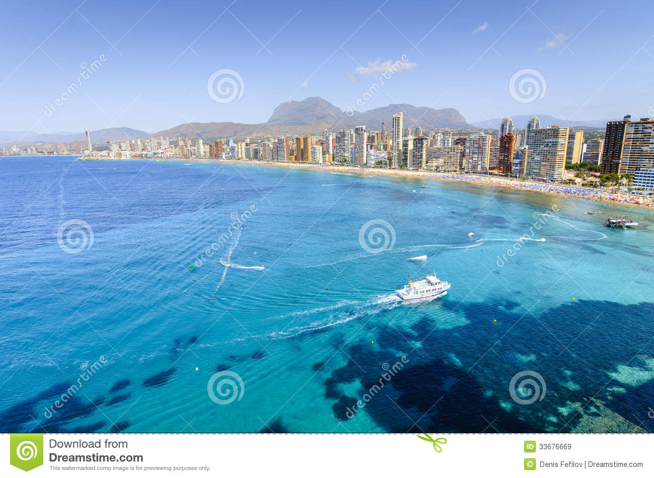 Wide angle shot on Levante beach in Benidorm bay, view on Puig Campana ...
