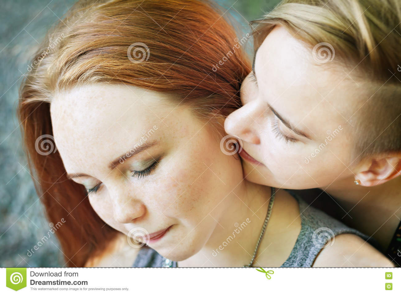 lgbt women. young lesbian couple walking in the park together
