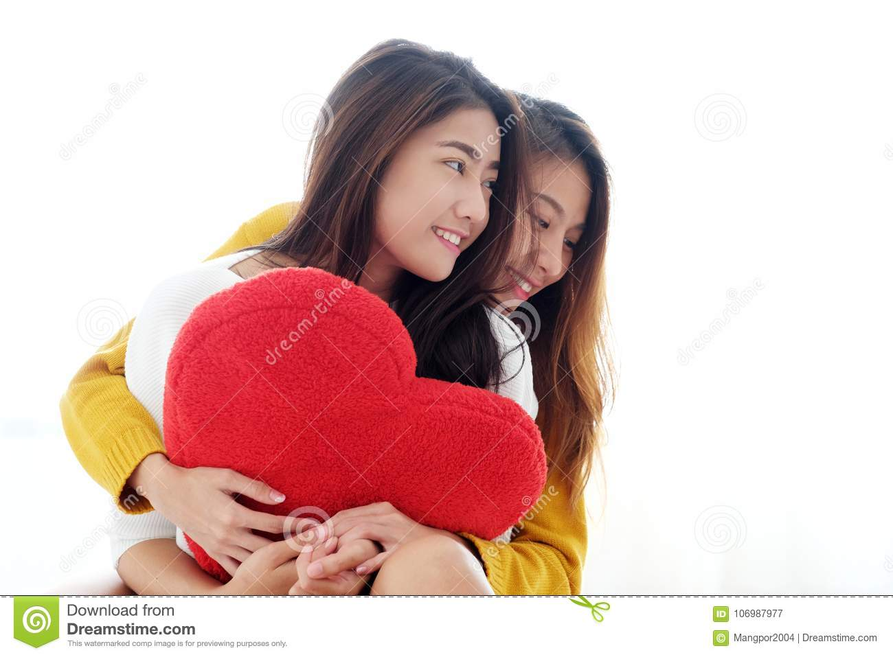 LGBT, Young cute asia lesbians huging and holding red heart shape willow together with happy smiling, couple