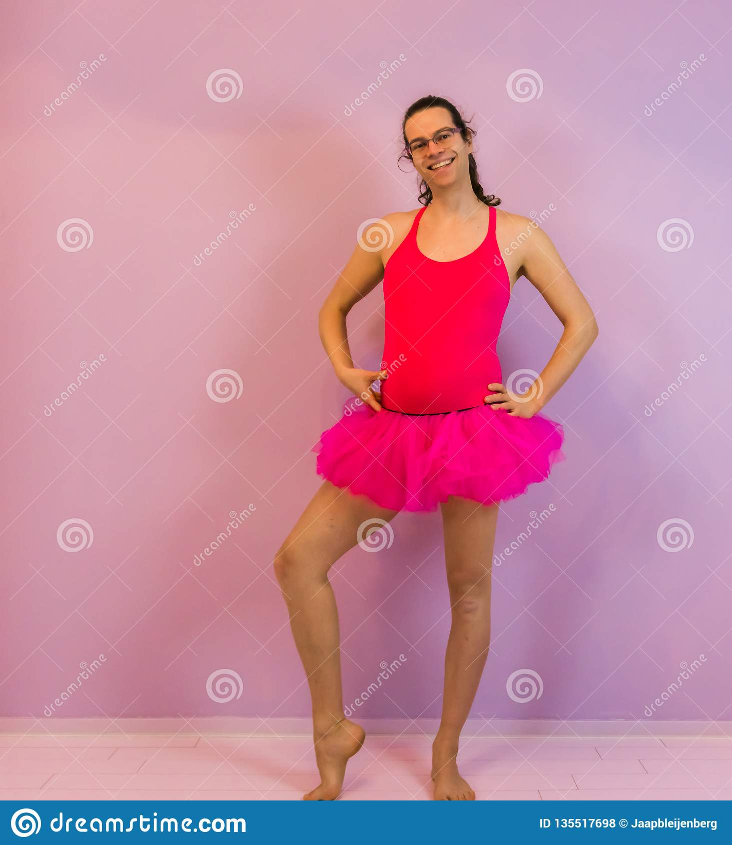 56de13c244e53c LGBT concept, Young transgender girl posing in a pink girly tutu, portrait  of a ballerina. More similar stock images