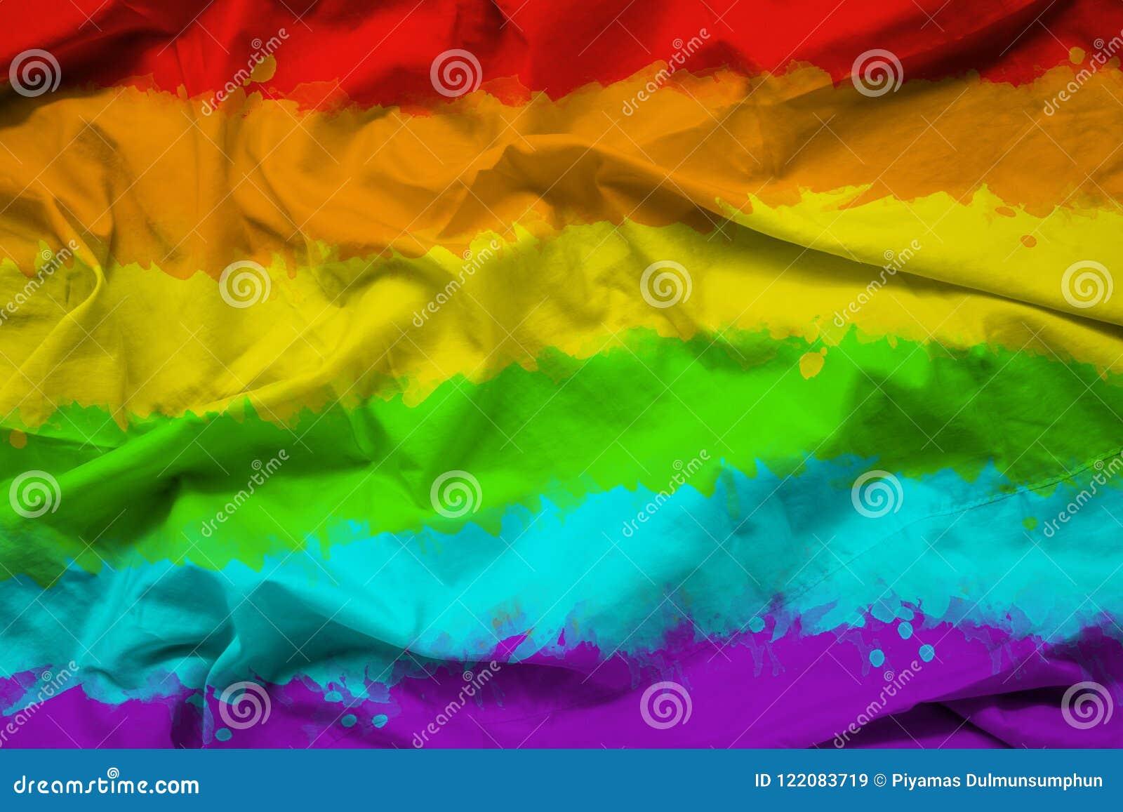 LGBTQ彩虹旗子为在织品纹理的自豪感月与波纹