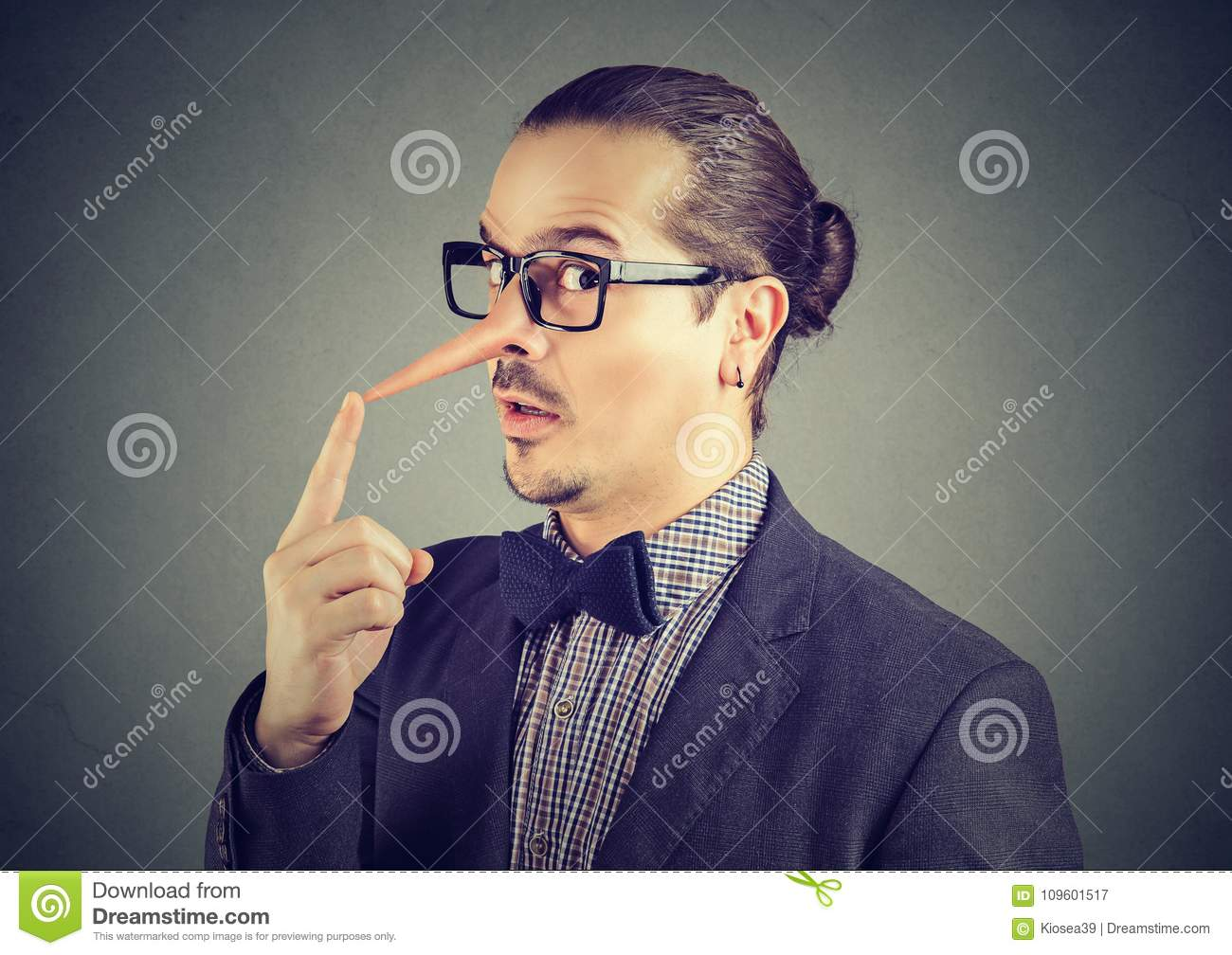 Liar business man with long nose
