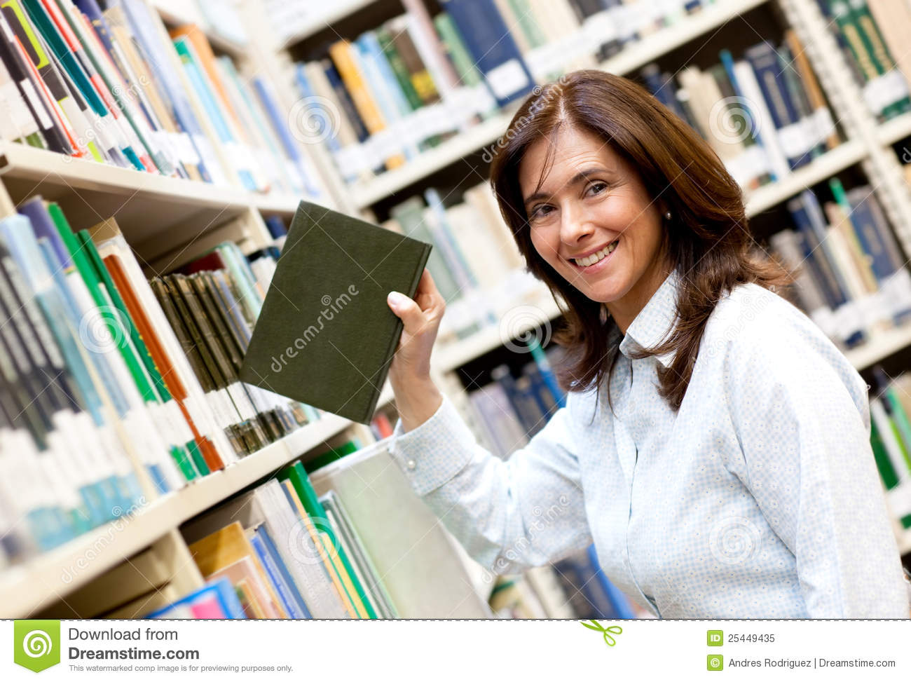 Librarian Placing A Book Royalty Free Stock Photo - Image: 25449435