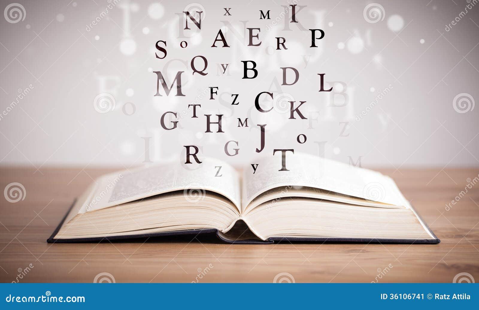 Libro abierto con las letras del vuelo imagen de archivo for Foto di un libro