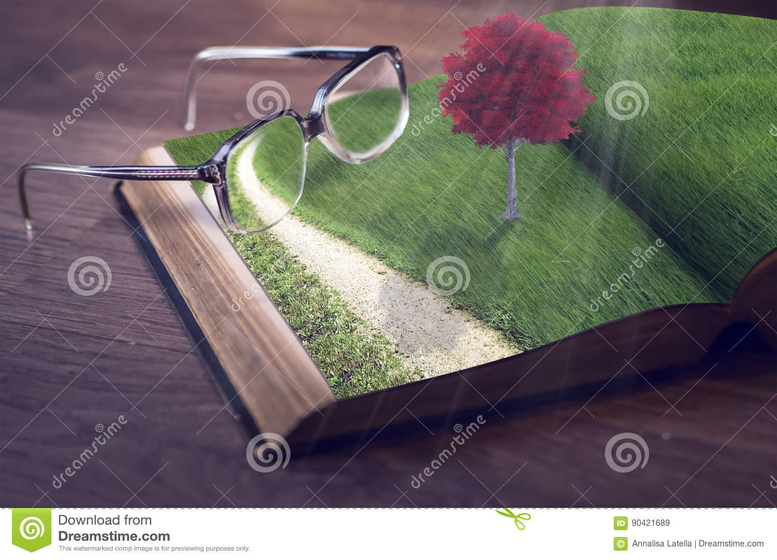 Libro con el árbol y las lentes rojos